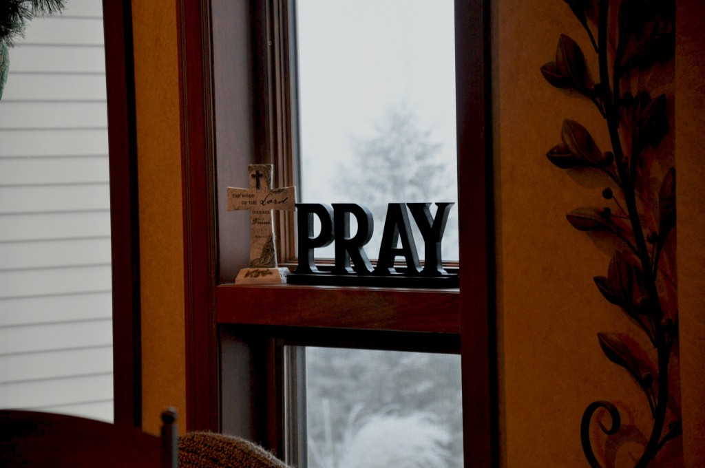 pray on windowsill