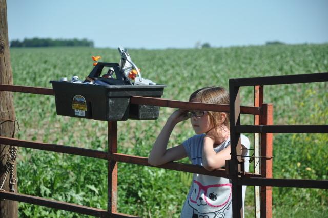 farm girl at gate