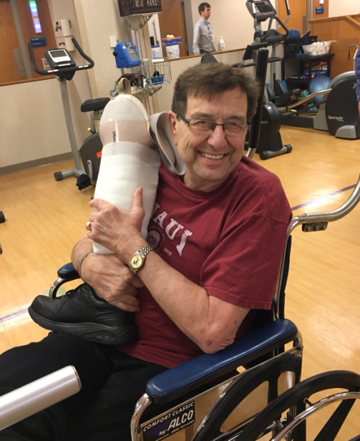 Dad, making friends with his new leg. :)
