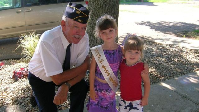 veteran with granddaughters, veterans day